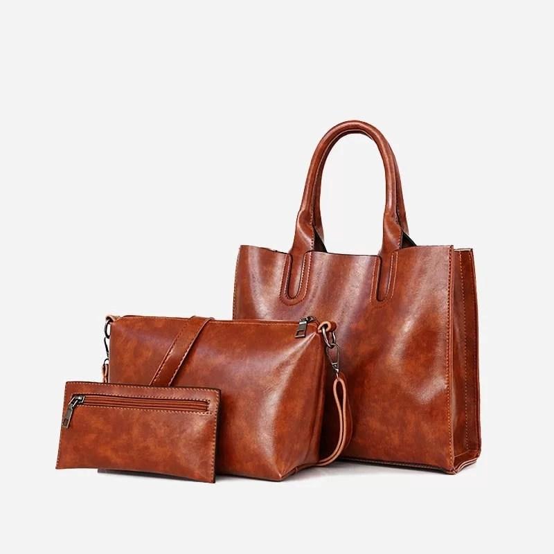 Set de sacs pour femme en cuir marron. Sac à main., sac bandoulière et pochette.