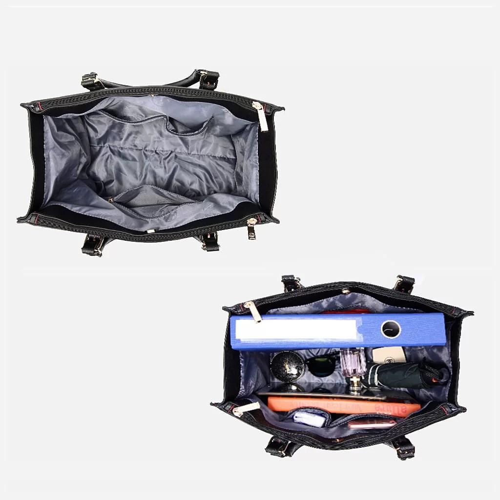 Intérieur du sac à main cabas pour femme en cuir noir avec bandoulière.