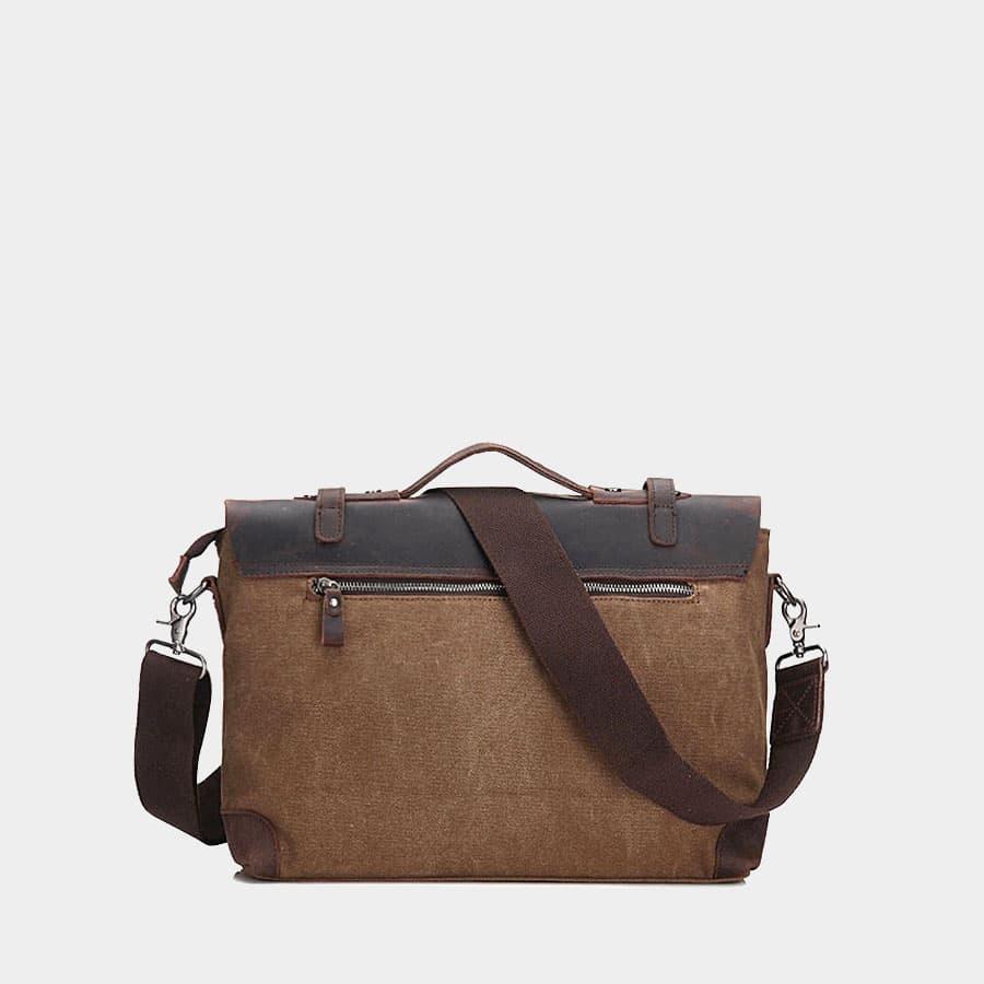 Verso de la sacoche besace en toile marron et cuir véritable brun foncé.
