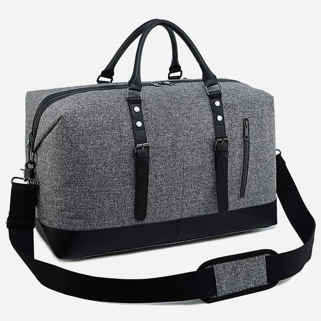 Détails du sac voyage en toile et en cuir gris et noir pour homme et femme.