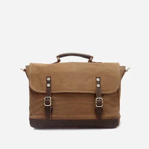 Sacoche besace en toile et en cuir marron et brun.