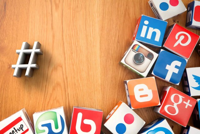 Social media cubes on a wooden background
