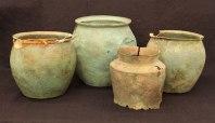 Three Roman buckets (first century CE) and one Etruscan bucket (third century BCE)