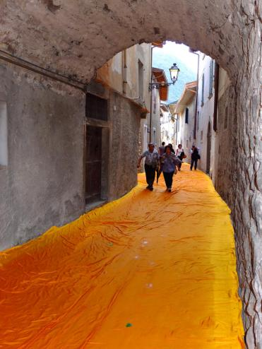 Christo and Jeanne-Claude, The Floating Piers, Lake Iseo, Italy, 2014-16. The fabric-covered streets of Sulzano. Photo: Wolfgang Volz © 2016 Christo