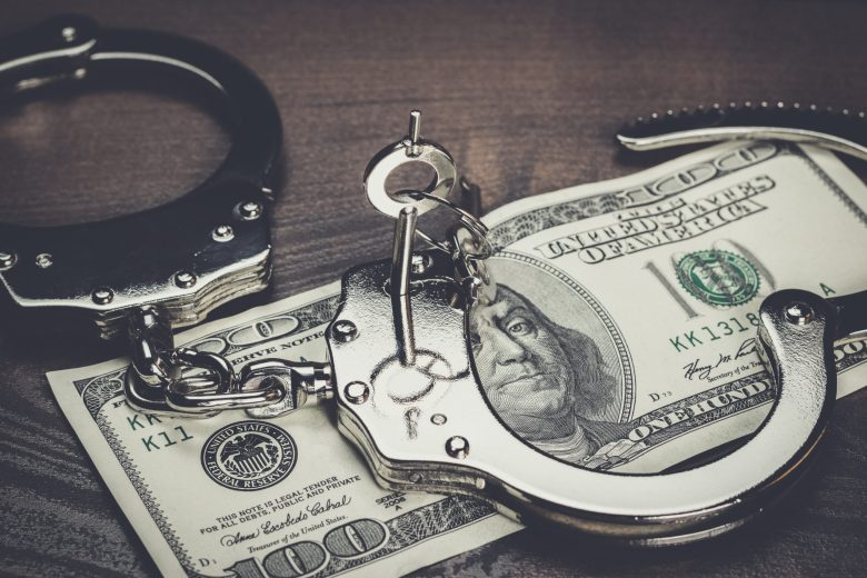handcuffs-and-one-hundred-dollars-on-the-table-PDBD66U-scaled.jpg (2560×1707)