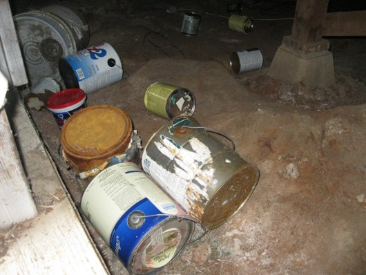 Photo of paint cans in the crawl space