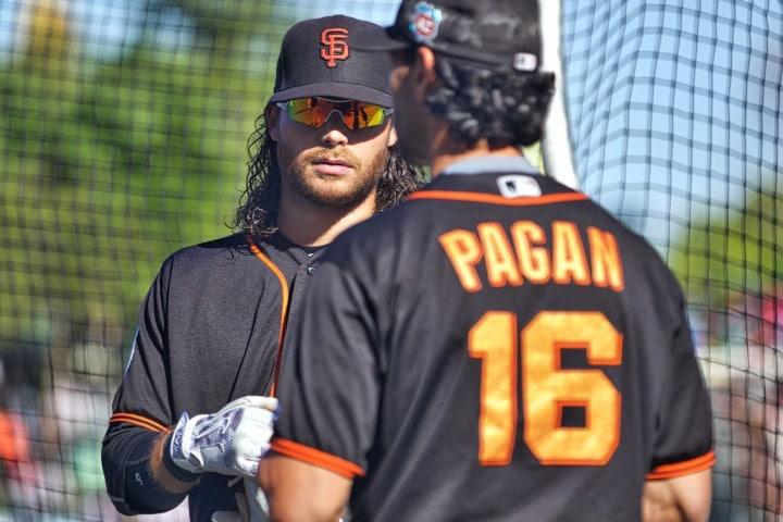 Brandon Crawford and Jose Pagan talk shop during batting practice before the game.