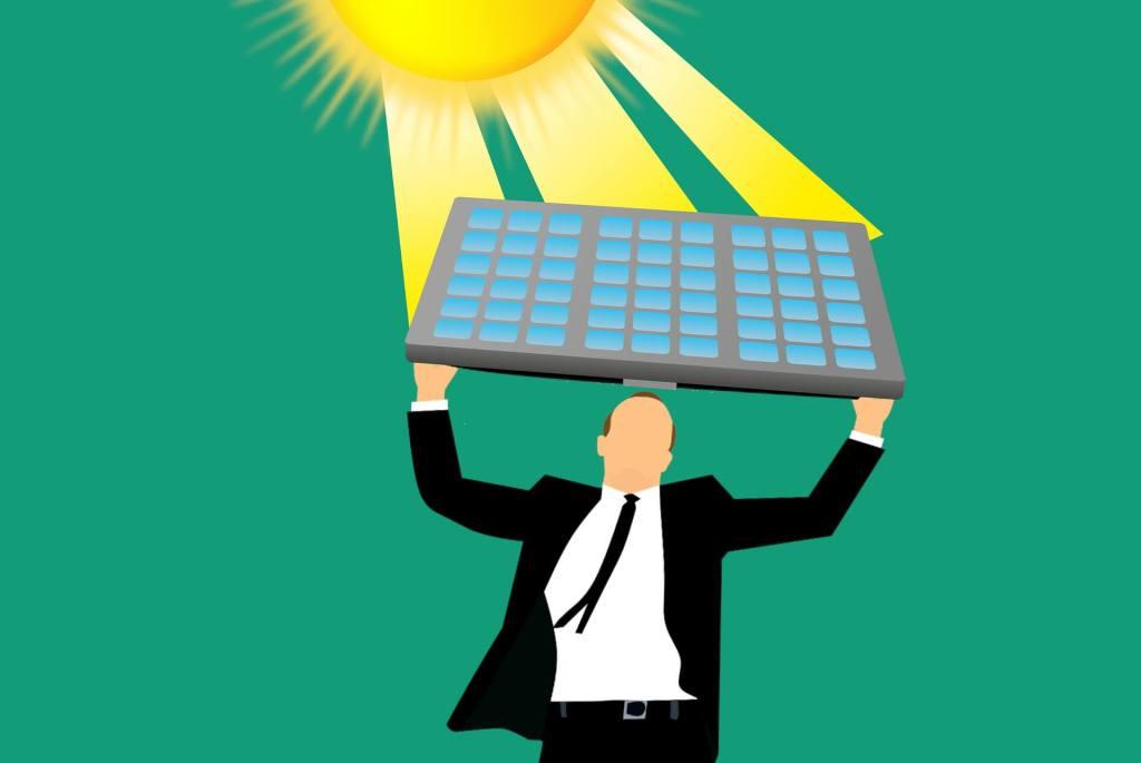man lifting a solar panel