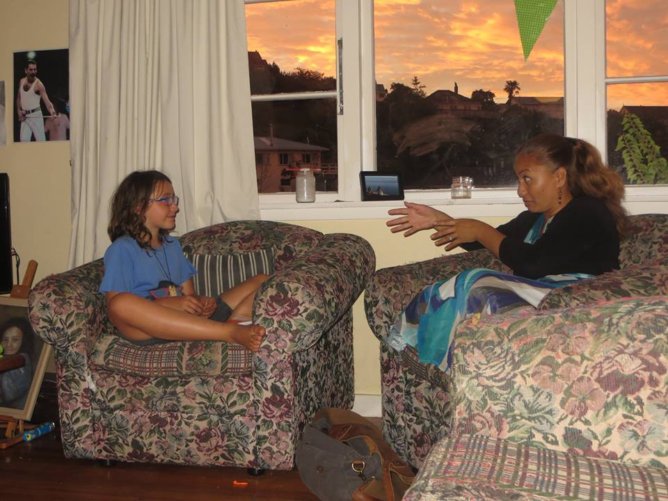 Jessica talking to Member of Parliament Marama Davidson, having invited her to come and visit her house.