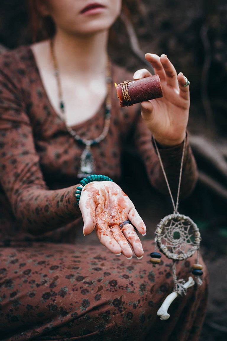 Girl learning Wicca and Witchcraft with Sacred Mists.