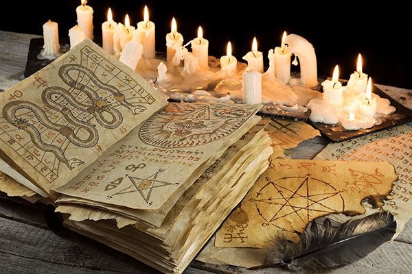 Wicca and Witchcraft book with lit candles