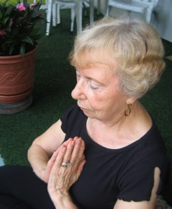 meditating hands in Anjali mudra prayer pose