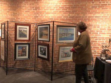 Jennifer Barber, Architect, admiring painting by Edward Brummal.