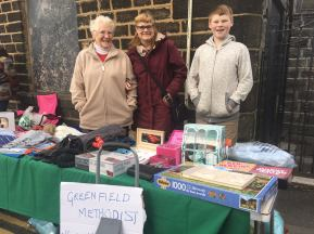 Phyllis Haigh, Denise Allonby and James Allonby at the Greenfield Methodists stall, raising funds for Whit Friday