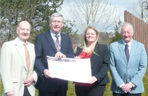 CHEQUE: Doug Greenwood (secretary), John Ainley (chairman) and Peter Mallinson (treasurer) with Claire Crossfield