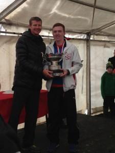 Adam Howard receives medal from Olympic Games silver medallist Steve Cram