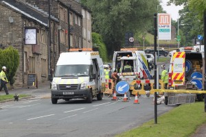 WAR ZONE: Gas engineers set to work to repair the broken gas pipe after workmen accidentally damaged it
