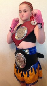 WINNER: Angel proudly displays her two title belts