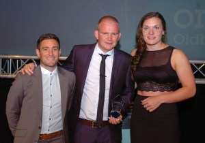 Pete Wild (centre), winner of the Coach of the Year award