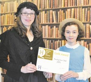 Mrs Liz Oliver and Nina Jones with the award