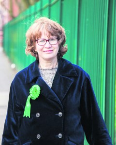 Miranda with green fence