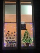 52nd Oldham (Uppermill) Rainbows' window created for the Uppermill Advent Calendar