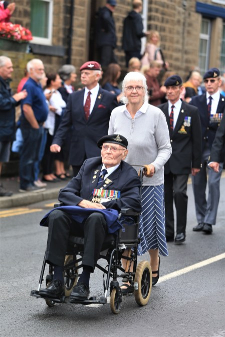 A veteran leads the parade