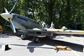 A youngster gets a birds eye view of a Spitfire at Saddleworth School