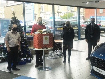 The Accrington dealership with items they collected for the foodbanks