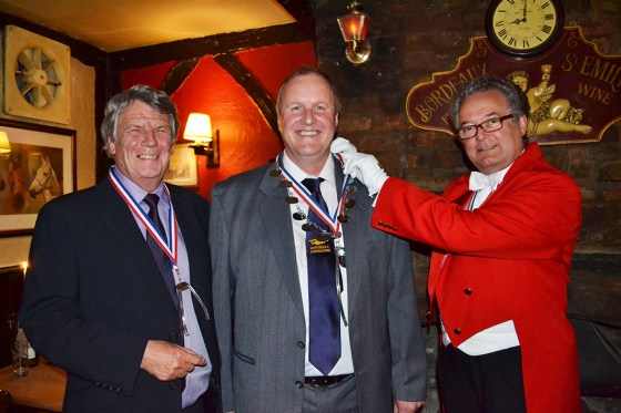 NEW MAYOR: David Needham (left) and Roger Fielding (right) invest David Buckley with his Chain of Office