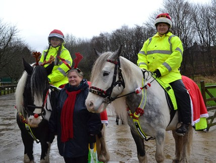 Claire Lowe on Katie, Lesley Ardrey and Chantelle Statham on Val at the Horseman's Carol Service