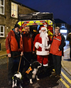Santa with OMRT members Mick Nield, Nigel Clegg and Paul Durvan with dogs Bobs and Dave