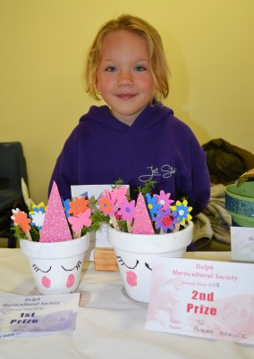 Poppy Garlick with her decorated plant pots which won first place