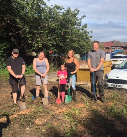 Katie Bowker and volunteers working on Dexter's Garden