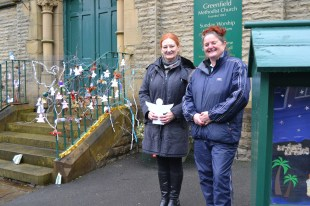 Greenfield Methodist angels being placed by Sue Titmuss and Rachel Fish