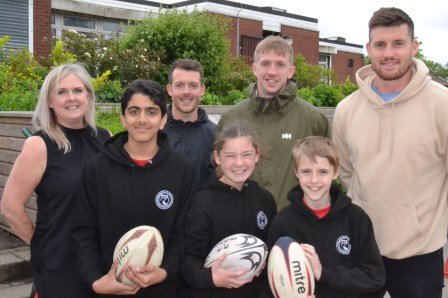Rugby: Year 6 pupils Alesar Khan, Mason Abernethy and Lydia Mayall with Joe Greenwood, headteacher Vanessa Payne, sports co-ordinator Tommy Bunn and year 3 teacher Ethan Langhorn