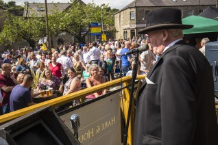 Winston Churchill adresses the large crowd at the Hare & Hounds