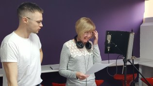 Jackie Hall recording her radiotherapy story, with Nathaniel Hall