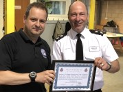 Matt Neild and GMP Chief Superintendent, Neil Evans with Certificate of Recognition