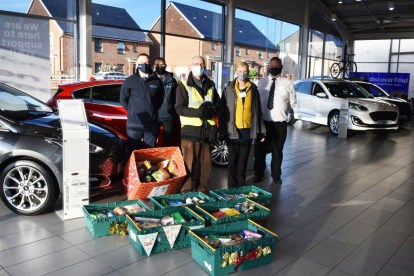 The Rochdale dealership with items they collected for the foodbanks