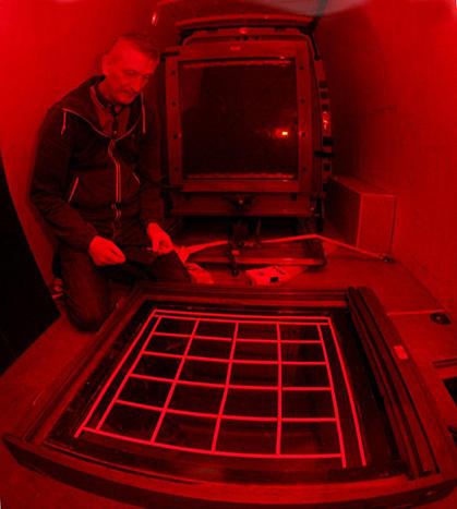 ian using the van as a mobile darkroom