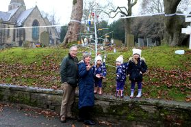 The Campbell family take a look at the unusual site of a Christmas Tree at the Christ Church graveyard in Friezland (Picture by Carl Royle)