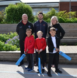 Cricket: Anthony Wilson with Paul Shea, Vanessa Payne, and Year 3 pupils Ellie Rigby, Jake Baker and Micah Grady
