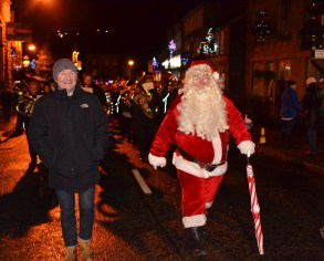 Father Christmas and Mike Sweeney lead the procession in Delph