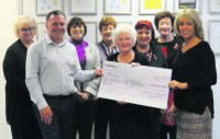 Dedicated Woman of Oldham committee fundraisers present £5,000 to POINT