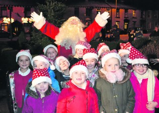 The primary school choir with Father Christmas at Springhead