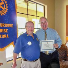 Dick Kroese, President of the SaddleBrooke Sunrise Rotary Club, presenting Bob Logan with a certificate of appreciation at a recent breakfast meeting.