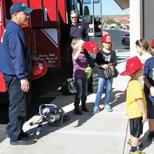 It's a hit when Golder Ranch Firefighters show the kids how a real fire truck works; photo by Jim Smith.