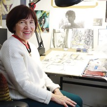 Marilynn Davis pauses in her studio surrounded by tools and partially created works.