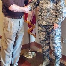 Doug Sweetland, President of SaddleBrooke Sunrise Rotary, and Colonel Rodger Schuld